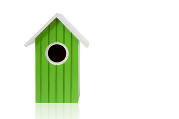 green nest box birdhouse house for birds isolated on white background with reflection