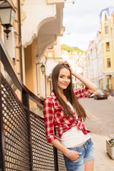 pretty young woman walking on a city
