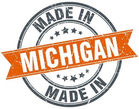Michigan orange grunge ribbon stamp on white