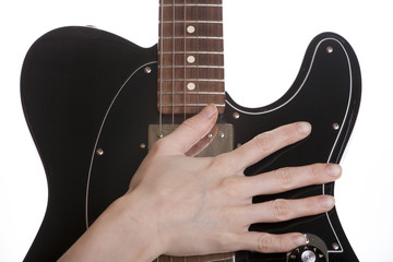 female's hand and guitar on a white background