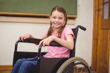 Disabled pupil smiling at camera