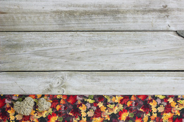 Blank rustic sign with autumn foliage and rope hearts border