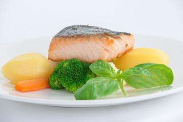 salmon fillet with potato on the white plate