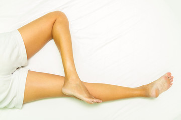 Slim legs of women on white background.
