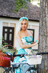 Romantic girl standing near old house