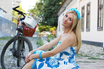 Romantic girl with bicycle sitting