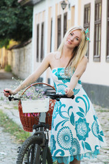 Romantic blonde girl with bicycle