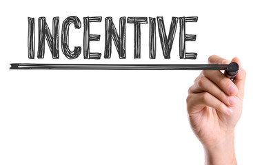 Hand with marker writing the word Incentive