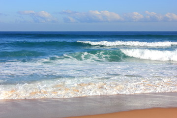 Blue ocean with wite capped waves and sky on horizon