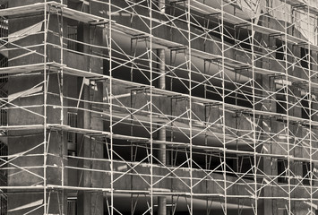 New commercial building construction site scaffolding, black and white photo