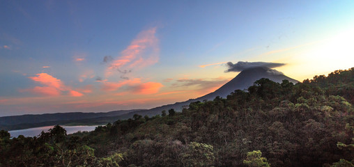 "A ""Cap"" forms over Arenal Volcano in Costa Rica, at Sunset"