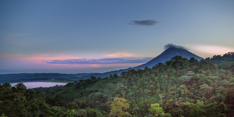 As dusk approaches, Arenal Volcano and Lake Arenal in Costa Rica, take on mystical feelings