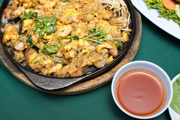 Thai food, fried mussel pancake in hot pan