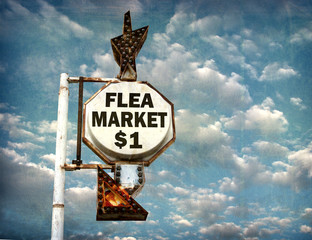 aged and worn vintage photo of flea market sign with cloudy sky