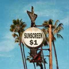 aged and worn vintage photo of sunscreen beach sign