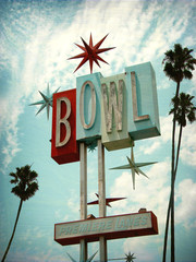 aged and worn vintage photo of retro neon bowling alley sign