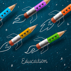 Education. Rocket ship launch with pencils - sketch on the