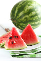 Tasty slice of watermelon on white wooden background