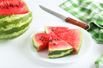 Tasty slice of watermelon on white wooden background