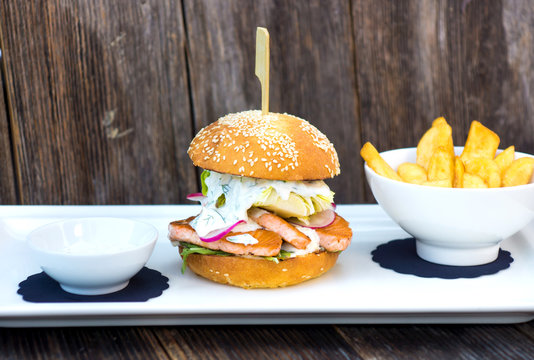 Tasty salmon fish burger