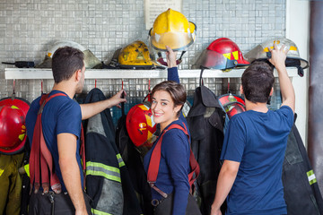 Firefighters Getting Ready In Fire Station