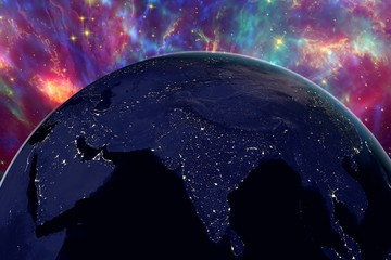 The Earth from space showing India and Arabian peninsula on surrealistic background with stars and galaxies in night, elements of this image furnished by NASA, other orientations available