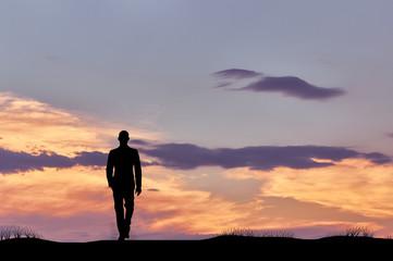 Silhouette of man walking businessman