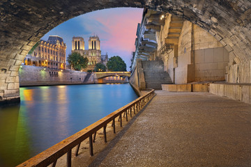Garden Poster Paris Paris. Image of the Notre-Dame Cathedral and riverside of Seine river in Paris, France.