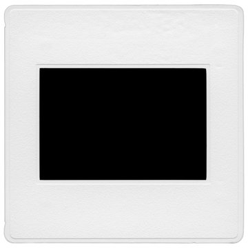 A scanned 35mm slide mount isolated on a white background. This is an actual slide mount which has been scanned. The frame is blacked out.