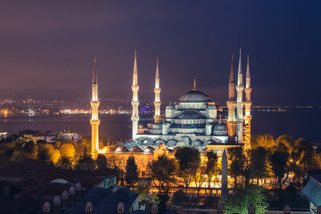 Istanbul, the Blue Mosque at sunset, as seen from an elevated position behind the mosque the illuminated city