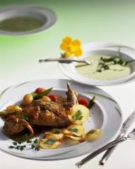 Cream of rocket soup and rabbit leg with potato crisps