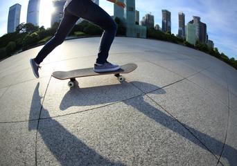 skateboarder skateboarding at sunrise city sunrise city