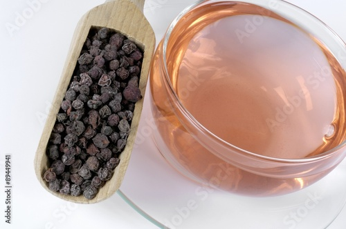 Dried schisandra berries and a cup of schisandra tea