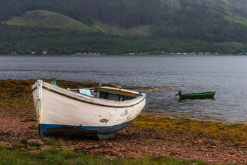 Fisherman boat in a lake shore, Scotland