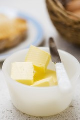Pieces of butter in a dish