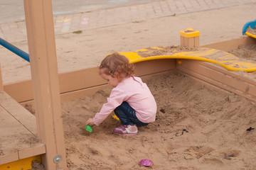 girl in a sandbox
