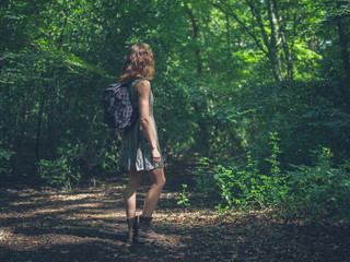Woman with backpack in forest