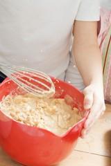 Children making muffin mixture