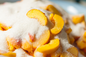 Ripe apricot slices with sugar. Cooking jam. Selective focus and