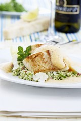 Fried zander on barley and herb risotto