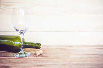 vintage cork from wine bottle and glass on the old wood floor.