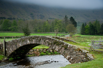 Ancient Stone Bridge in St John's in the Vale, Lake District National Park, Cumbria, England.