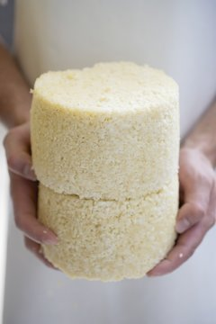 Person holding Graukäse (Grey cheese)