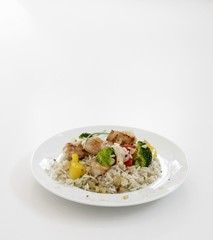Fried chicken breast with vegetables on rice