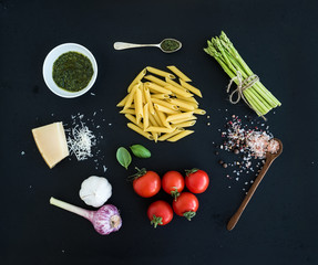 Ingredients for cooking pasta. Penne, green asparagus, basil