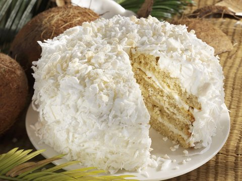 Coconut cake with a piece removed