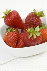 Fresh strawberries in a small bowl