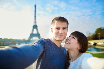 Young romantic couple taking funny wide angle selfie
