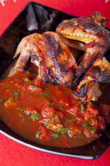 Grilled chicken wings with salsa