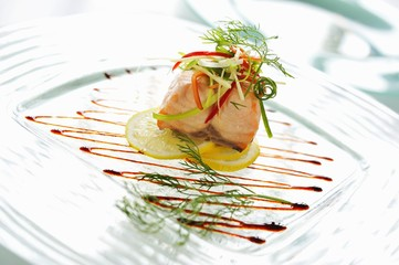 Steamed salmon with vegetables and herbs (Asia)